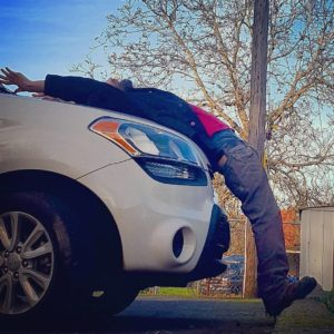 Using the car as a yoga prop